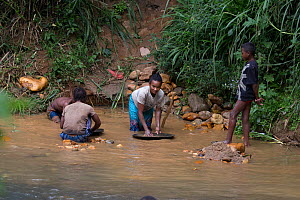 Locals panning for gold, Kianjavato, Madgascar . - TJ Rich