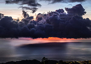Dramatic sunset with storm clouds over Roseau, Caribbean sea view in Dominica, Lesser Antiles. September 2019.  -  Derek Galon