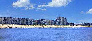 Tourists on the beach and flats and apartments at Nieuport / Nieuwpoort, seaside resort along the North Sea coast, West Flanders, Belgium 2019  -  Philippe Clement