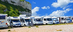Motorhomes parked along the French coast at Saint-Valery-en-Caux in summer, Seine-Maritime, Normandy, France 2019 - Philippe Clement