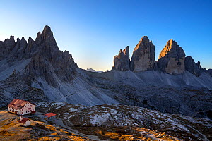 Mountain refuge Dreizinnenhutte / Rifugio Antonio Locatelli at sunrise and the Drei Zinnen / Tre Cime di Lavaredo in the Dolomites, South Tyrol, Italy, October 2019  -  Philippe Clement