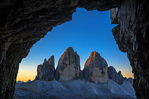 Tre Cime di Lavaredo / Drei Zinnen, three distinctive mountain peaks in the Sexten Dolomites seen from WW1 cave shelter, South Tyrol, Italy, October 2019  -  Philippe Clement
