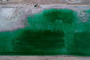 Abandoned pond used for the disposal and stacking of phosphogypsum in Huelva, Southern Spain. Phosphogypsum is a radioactive by-product in the manufacture of phosphoric acid, used for phosphate-based...  -  Milan Radisics