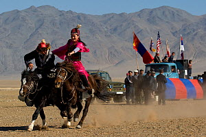 Kyz Kuar race in which the lady races past the man, and the man attempts to catch up in order to 'steal a kiss'. If he manages to kiss her he wins, and if she whips him she wins. Altai, Mongol...  -  Klein & Hubert
