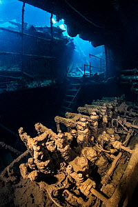 The engineroom (this is a generator, not the main engine) of the Chrisoula K wreck (also known as the tile wreck). Abu Nuhas, Egypt. Strait of Gubal, Gulf of Suez, Red Sea.  -  Alex Mustard