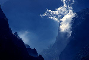Landscape of silhouetted mountains and cloud in Madeira - Edwin Giesbers