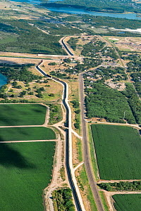 Border wall through agricultural land in Rio Grande Valley, aerial view. Mission, Hidalgo County, Texas, USA. July 2019.  -  Wendy Shattil