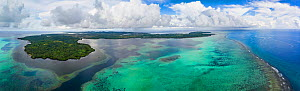 Aerial view above the outer reef and Goofnuw Channel looking south to the island of Yap, Micronesia. August 2017.  -  David Fleetham