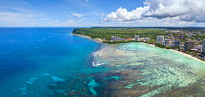 Aerial panorama of the north end of Tumon Bay with hotels and beach and Two Lovers Point, Guam, Micronesia, Mariana Islands, Pacific Ocean. September 2017. - David Fleetham