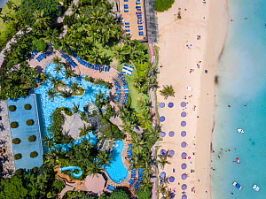 Aerial view of the pool and beach at the Outrigger Hotel on Tumon Bay, Guam, Micronesia, Mariana Islands, Pacific Ocean. September 2017. - David Fleetham