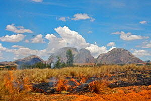 Burning grassland near the massif of the Three Sisters, granitic inselbergs, Madagascar.  -  Lorraine Bennery