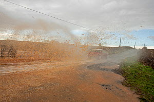 Car racing through flood water creating spray, Teme Valley, Worcestershire, Storm Dennis, 16 February 2020.  -  Will Watson