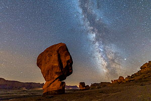 Cap-rock formations near the Colorado River, Echo Cliffs in background.  Milky Way over boulders at base of the Vermilion Cliffs. Glen Canyon National Recreation Area, Arizona, USA. September 2019.  -  Jack Dykinga
