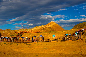 Tourists on walkway with Rainbow Mountains in background. Zhangye National Geopark, China Danxia UNESCO World Heritage Site, Gansu Province, China. 2018.  -  Sylvain Cordier