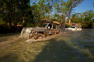 4x4 fording Nolan's Brook on the Overland Telegraph Line track route up the Cape York Peninsula, Queensland, Australia.  -  Tim  Laman