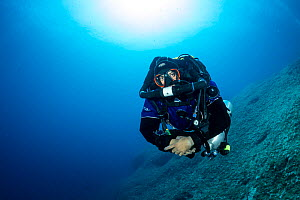 Rebreather diver or technical diver coming up from a dive on the airplane B-24 Liberator wreck, Vis Island, Croatia, Adriatic Sea, Mediterranean  -  Franco  Banfi