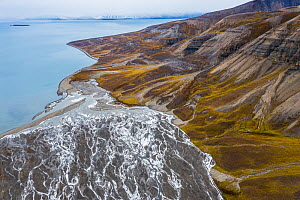 Aerial view of eroded mountain slopes at coast and rich network of river channels. Billefjorden, Skansbukta, Svalbard, Norway  -  Orsolya Haarberg