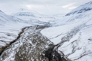 Aerial view of the snow-covered Bolterdalen valley in early autumn. Spitsbergen, Svalbard, Norway.  -  Orsolya Haarberg