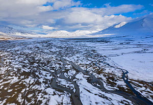 Aerial view of river delta and Arctic landscape covered by fresh snow in early autumn. Adventdalen valley, Svalbard, Norway. September.  -  Orsolya Haarberg