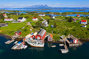 Aerial view of an island far out in the sea in Norway's widest strandflat. Fishing village with boats and boat houses. Brasoya, Helgeland Archipelago, Norway. July.  -  Orsolya Haarberg
