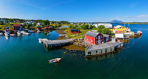 Aerial view of an island far out in the sea in Norway's widest strandflat. Fishing village with boats and boat houses. Husvaer, Helgeland Archipelago, Norway. July.  -  Orsolya Haarberg