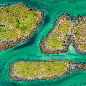 Aerial view of sporadically inhabited islands, Islets and skerries in a wide coastal plain. Husvaer, Helgeland Archipelago, Norway. July.  -  Orsolya Haarberg