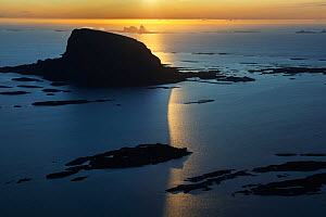 Aerial view of islands, scattered in a wide strandflat. Setting sun reflecting in the sea. Lovund and Traena, Helgeland Archipelago, Norway. July.  -  Orsolya Haarberg