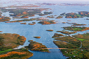 Aerial view of islands, islets and skerries, scattered in a wide strandflat. Heroy, Helgeland Archipelago, Norway. July.  -  Orsolya Haarberg