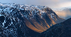 Melting snow in early May. Bergsdalen valley illuminated by late evening sunlight. Sogn og Fjordane, Hurrungane Mountains, Norway. May.  -  Orsolya Haarberg