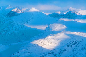 Snow-covered mountain landscape, viewed from Mt Loftet. Jotunheimen National Park, Norway. April.  -  Orsolya Haarberg