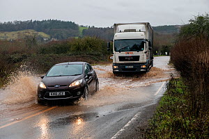 Vehicles driving through surface flood water, 20th December 2019, A44, Teme Valley, Worcestershire, England.  -  Will Watson