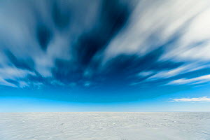 Flat expanse of ice and a cloudy sky, Atka Bay, Antarctica. August 2012. Bookplate.  -  Stefan Christmann