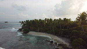 Drone shot tracking over an island at dawn, Maldives, 2019.  -  Laurie Hedges