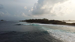 Drone shot tracking towards an island, Maldives, 2019.  -  Laurie Hedges