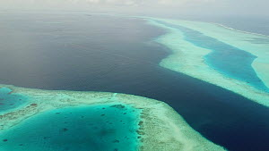Drone shot tracking over coral reefs and ocean, Maldives, 2019.  -  Laurie Hedges