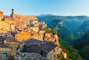 Ancient medieval hill town of Sorano at dawn looking over the Lente river valley, Tuscany, Italy, April 2010.  -  Guy Edwardes