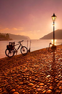 Bicycle by river at Bayard's Cove, Dartmouth, Devon, England, UK. November 2005.  -  Guy Edwardes