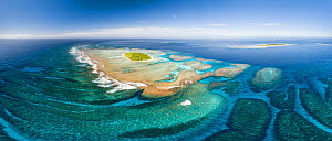 Aerial panorama of Maninita Island which sits atop an extensive coral reef structure, which is for the most part not visible from the surface of the ocean. Visible to the right behind Maninita is Taul...  -  Tony Wu