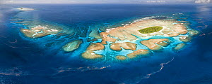 Aerial panorama of Maninita Island which sits atop an extensive coral reef structure, which is for the most part not visible from the surface of the ocean. The reefs extend into the smaller island of...  -  Tony Wu