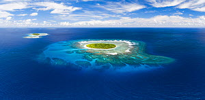 Aerial panorama of Fangasito Island with the underwater coral reef clearly visible, Vava�u island group, Kingdom of Tonga, South Pacific, with Fonua�one�one island visible in the background. September...  -  Tony Wu