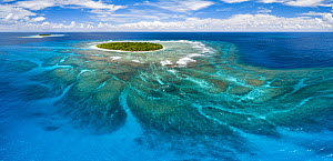 Aerial panorama of Fangasito Island with the underwater coral reef clearly visible, Vava'u island group, Kingdom of Tonga, South Pacific, with Fonua'one'one island visible in the background. September...  -  Tony Wu