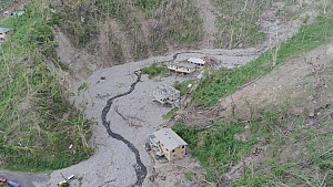 Aerial tracking shot showing aftermath of landslides, two months after hurricane Maria, Dominica, Lesser Antilles, 2018.  -  Derek Galon