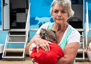 Wildlife rescuer and carer Lorna King leaves the mobile wildlife triage centre at Bairnsdale holding here male koala (Phascolarctos cinereus) named �River'. River was brought in for a health check dur...  -  Doug Gimesy