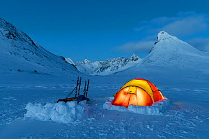 Photographers camping in the Jotunheimen mountains. Mt Kyrkja in the background. Norway. April 2020.  -  Erlend Haarberg