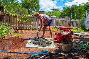 Photographer Tui De Roy building a new water lily pond with some leftover concrete during Covid-19 lockdown. Santa Cruz Island, Galapagos Islands April 2020  -  Tui De Roy
