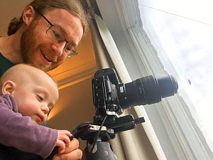 Photographer Alex Hyde working from home whilst carrying baby daughter during the Covid-19 Pandemic, April 2020  -  Alex Hyde