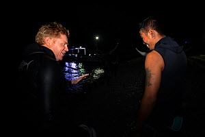 Photographer Magnus Lundgren, and local guide Dex discussing the coming night dive, Anilao, Balayan Bay, Mabini, Batangas, the Philippines. Minimum fees apply.  -  Magnus Lundgren