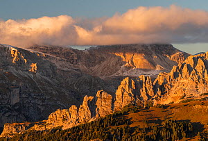 Looking north from Passo Sella, and the Odle Range, at sunset, Dolomites, Italy, October 2019.  -  John Shaw