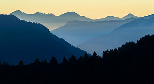 Mountains at twilight, seen from Passo Sella, Dolomites, Italy, October 2019.  -  John Shaw