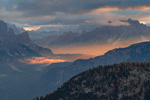 Sunrise light from Passo Giau, with fog in the Cortina valley, Dolomites, Italy, October 2019.  -  John Shaw